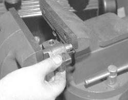 Place the tensioner into a bench vise