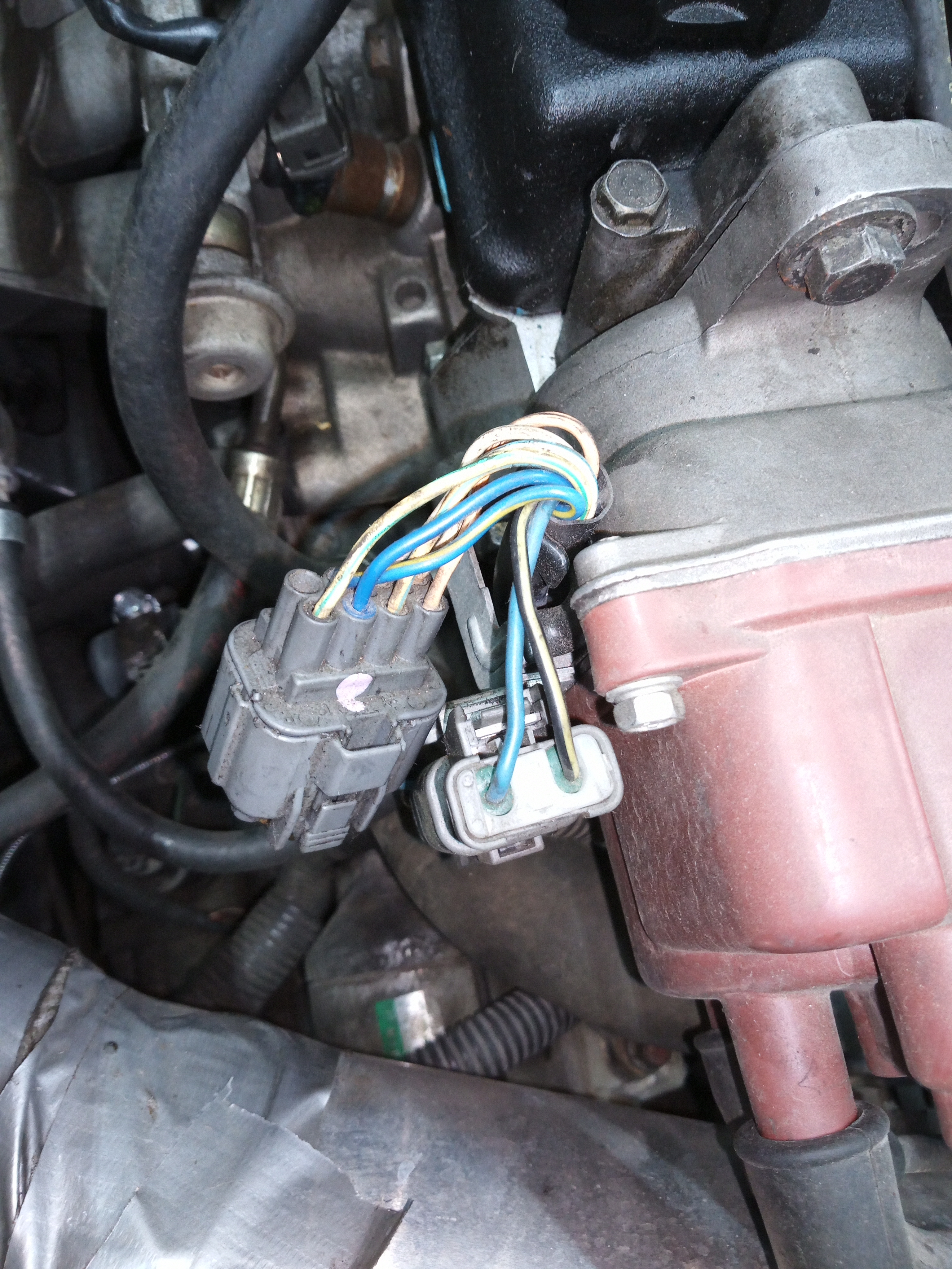 Where can I pick up a tach signal on a 1995 Acura Integra? I am installing  a simple aftermarket tach. This is OBD1 car | Acura Integra Tachometer Wiring |  | JustAnswer