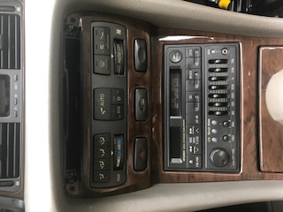 Instrument panel where the cup holder tray is located.JPG