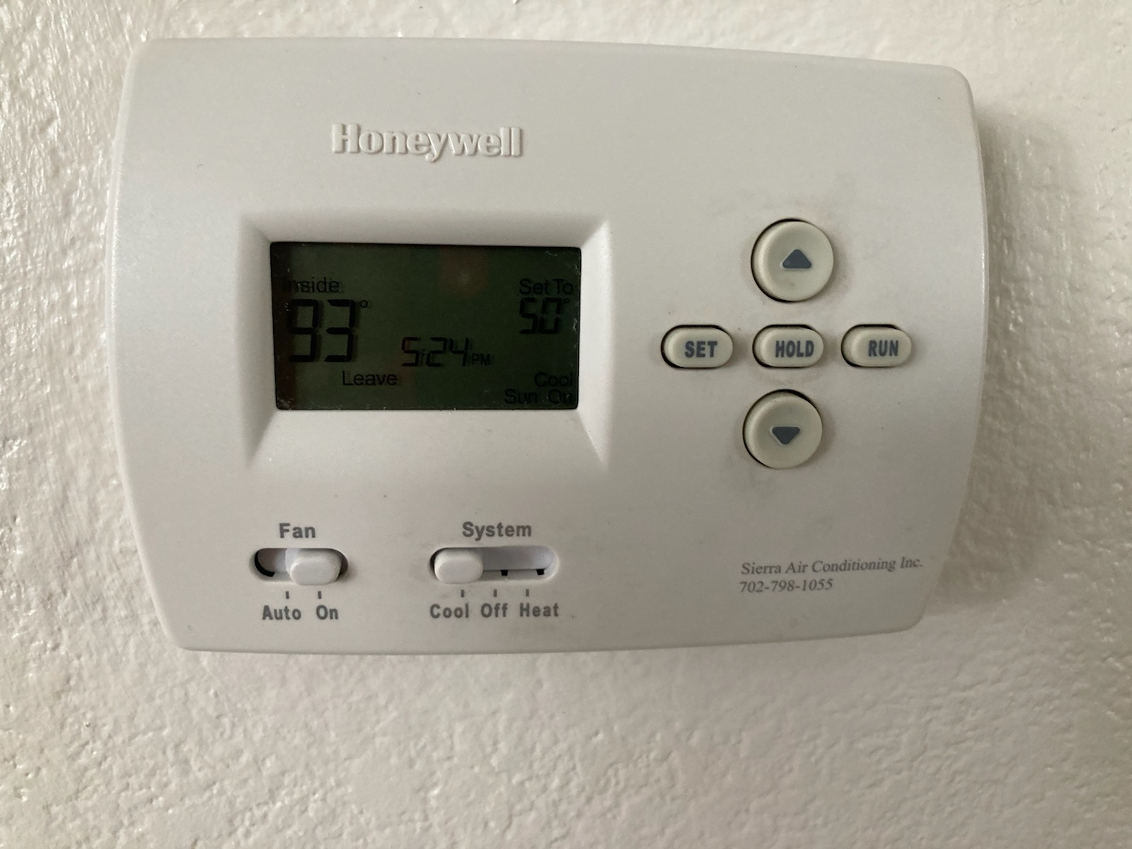 How do I reset my Honeywell Thermostat? About 14 years old