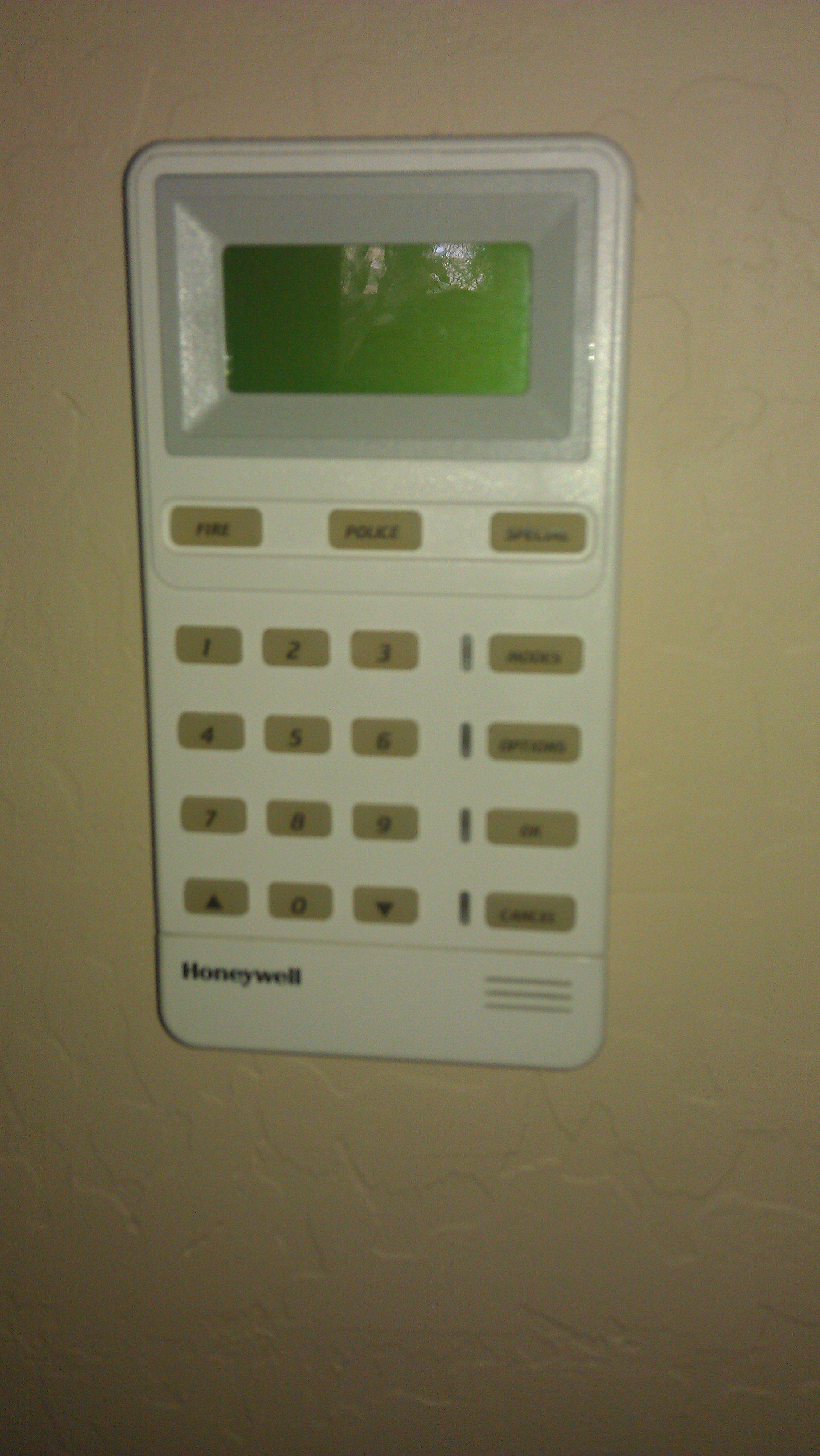 how to change alarm code on honeywell keypad