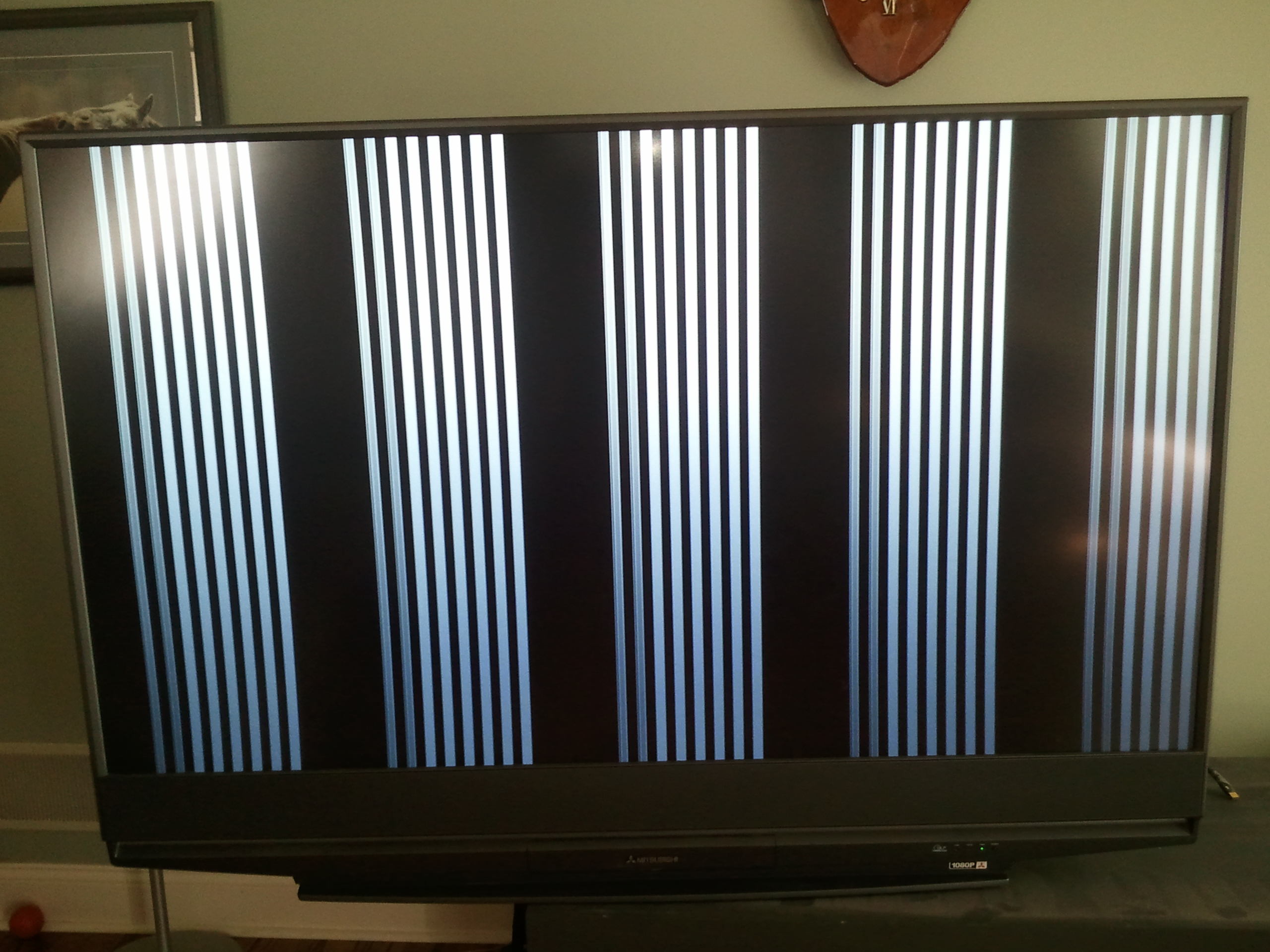 My Mitsubishi DLP TV, WD-65731, has and black vertical lines running