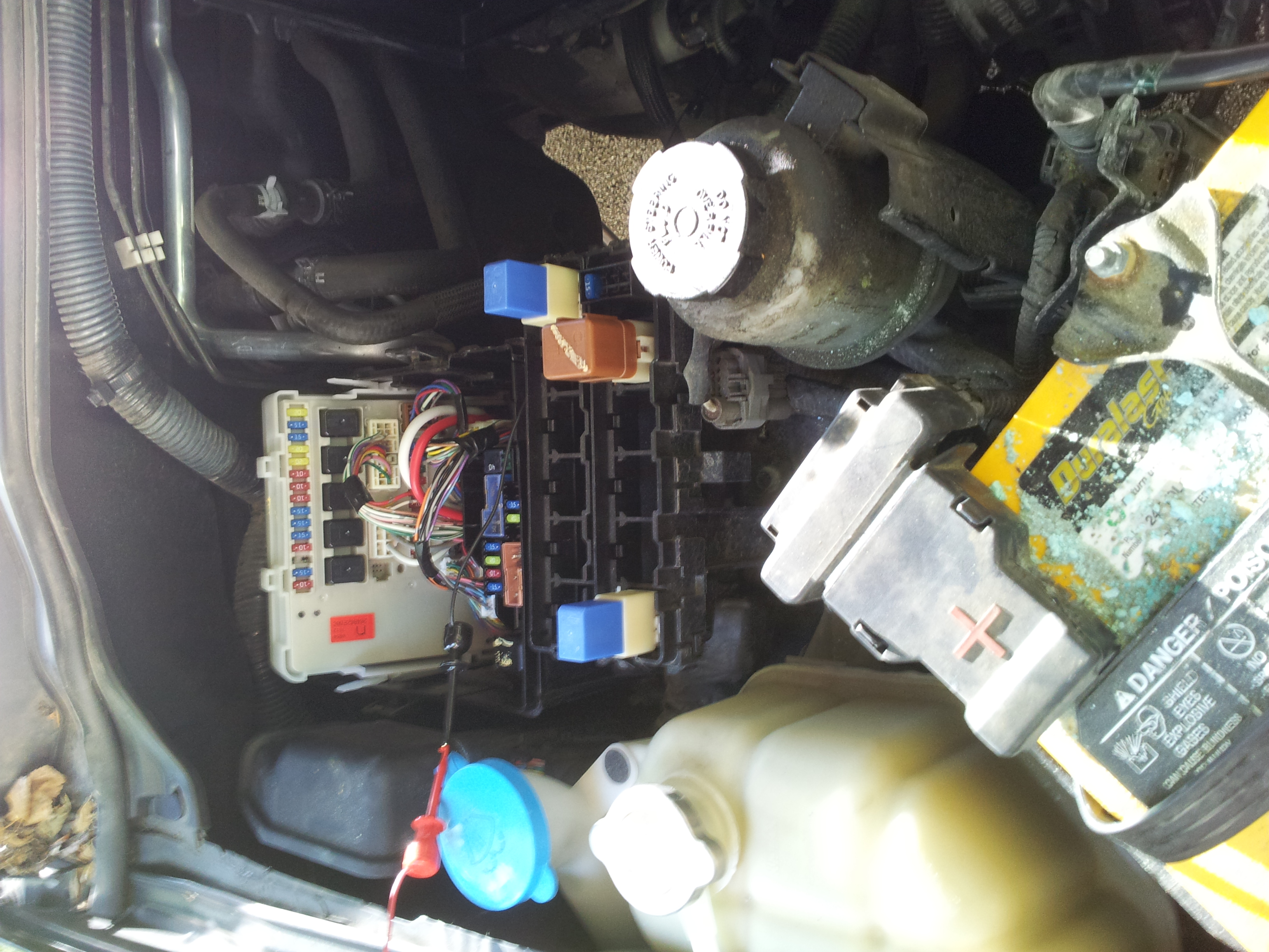 nissan frontier where is the clutch interlock relay in my