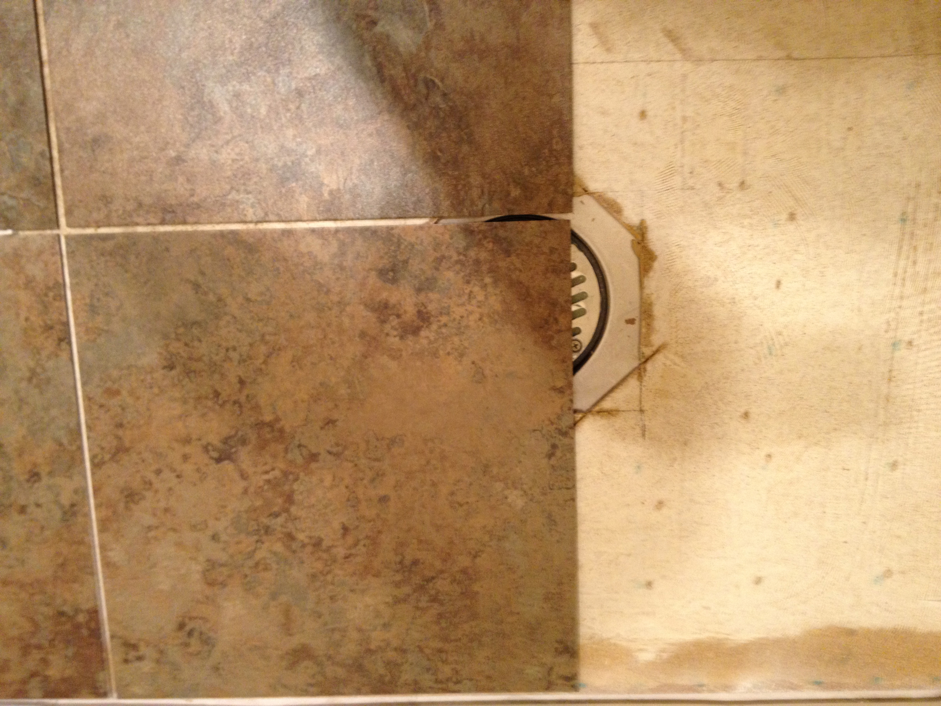 I need some tips and tricks for installing my vinyl tile around a drain and subfloor image tile laying over drain dailygadgetfo Choice Image