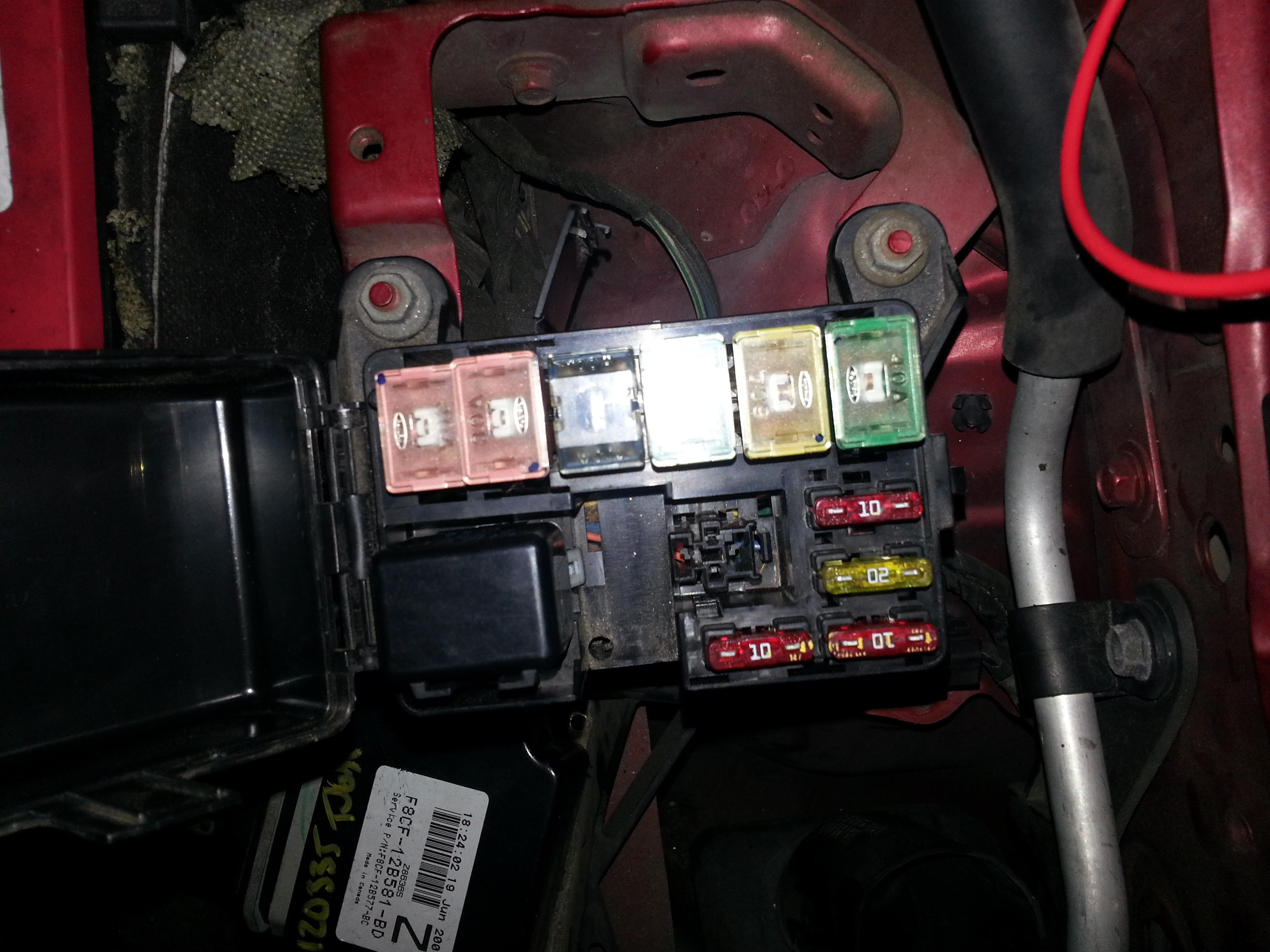 Fuse box inside engine
