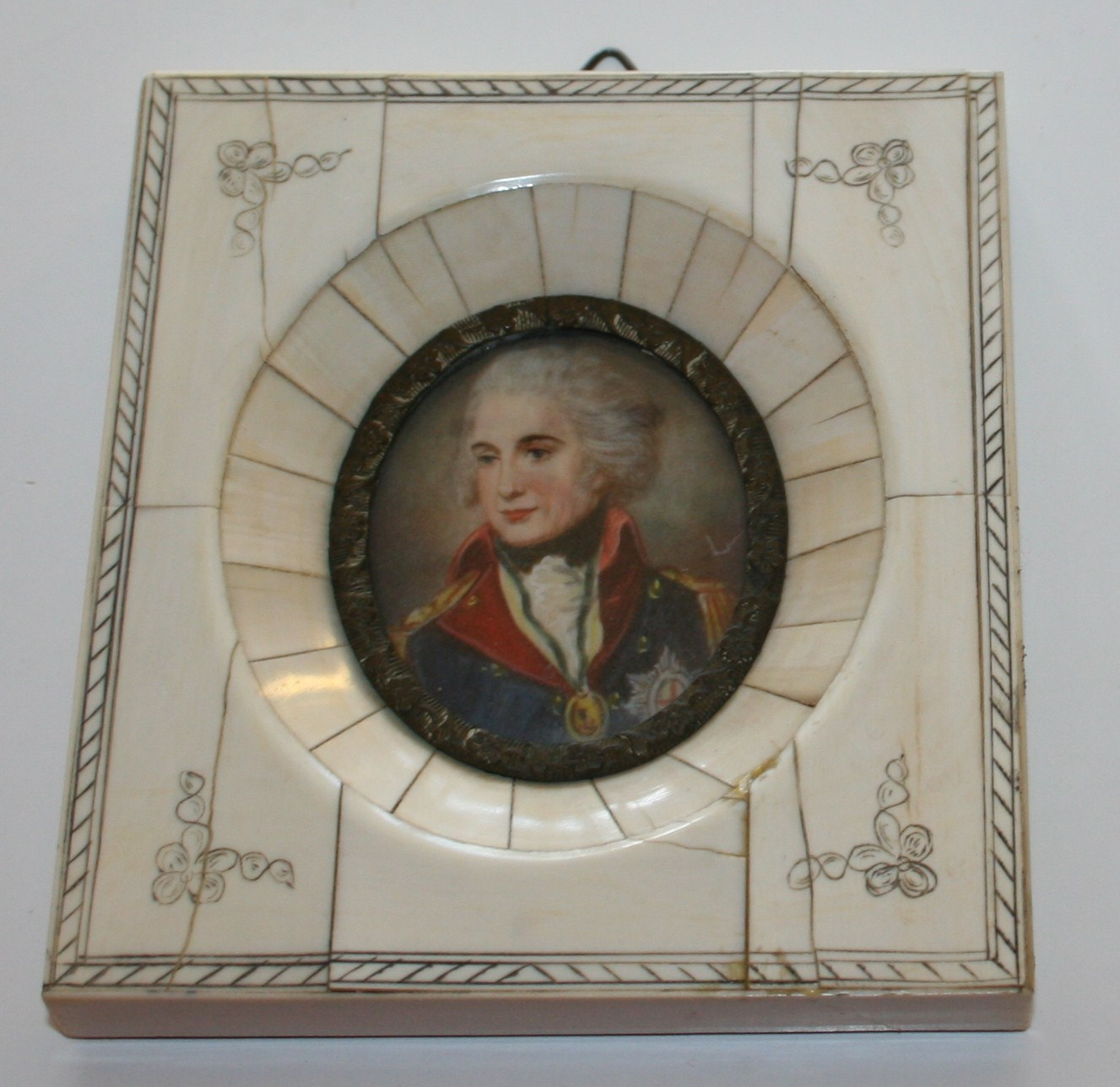 I have a miniature painting on ivory with an ivory frame of possibly ...