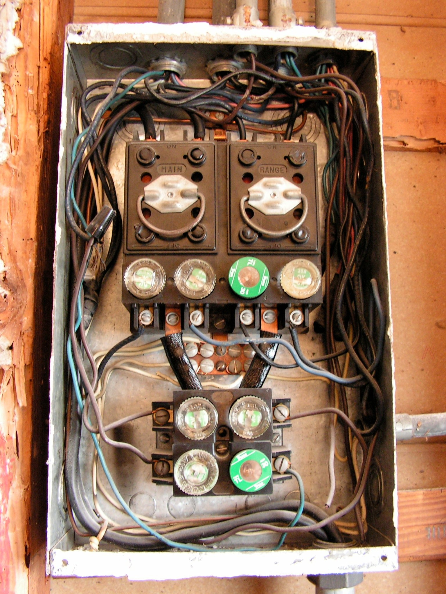 i need advice from an electrician who has tons of Old Electrical Fuse Panels 2012 07 20 204319 panel