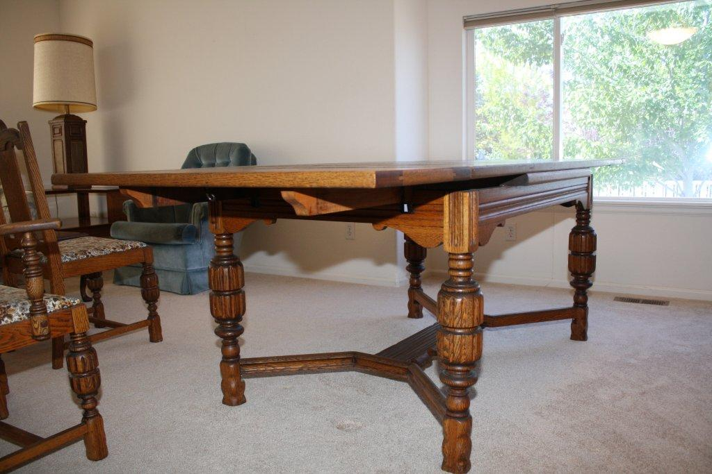 my parents have a hand carved oak antique dining room table,