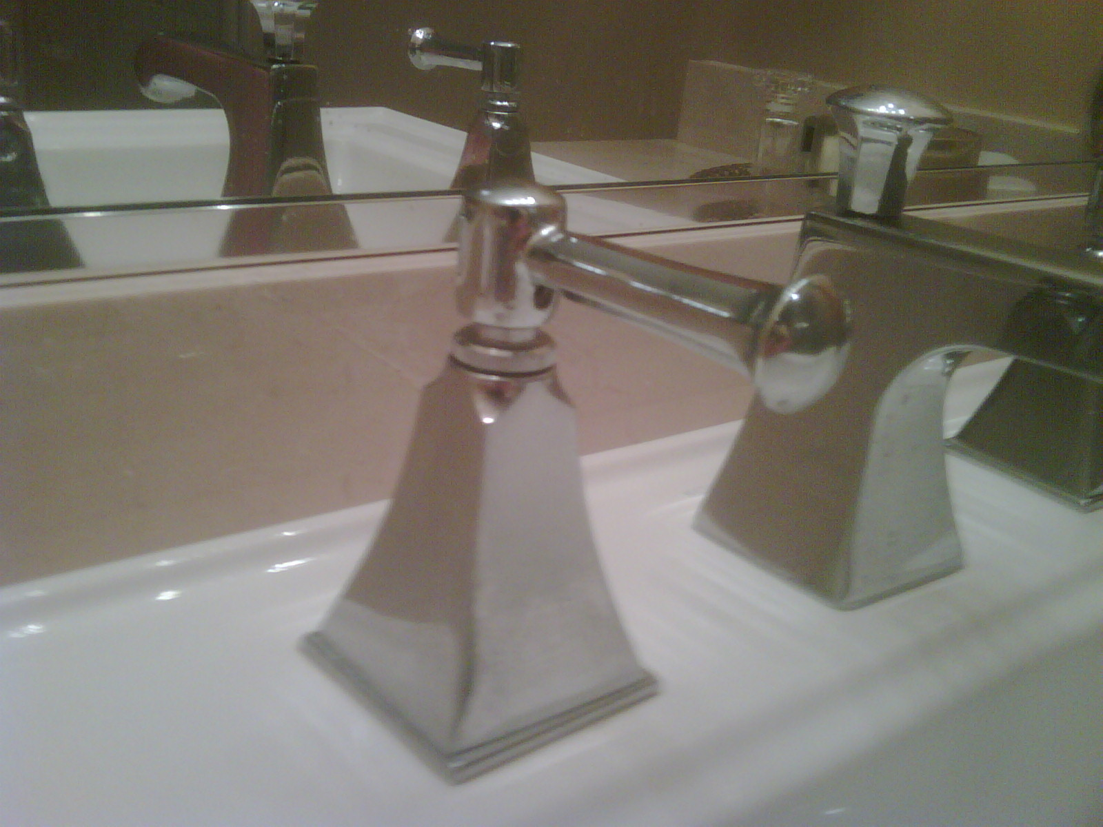 How do you remove a kohler bathroom sink faucet handle?