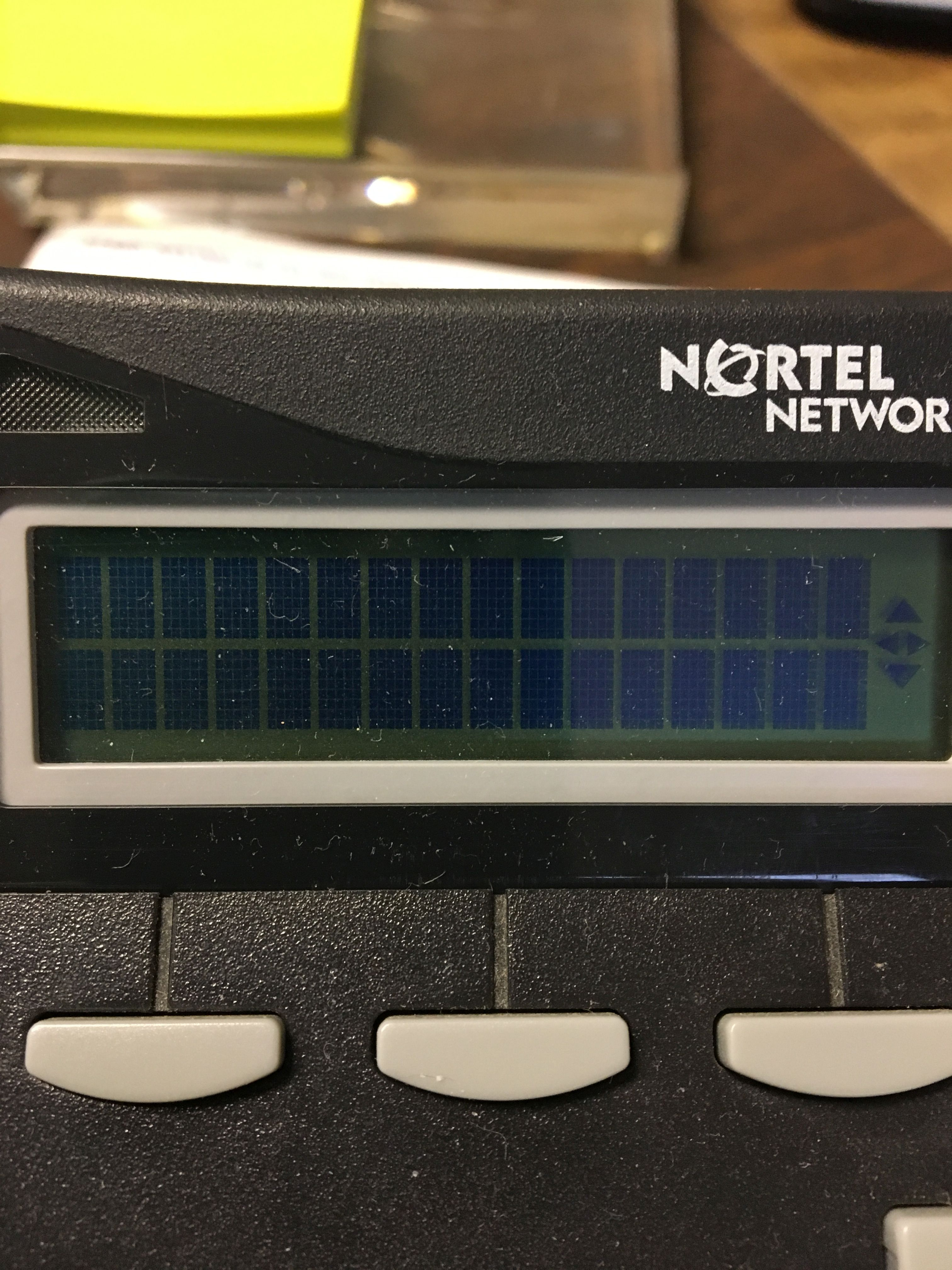My display screen on my T7316E Nortel phone is only