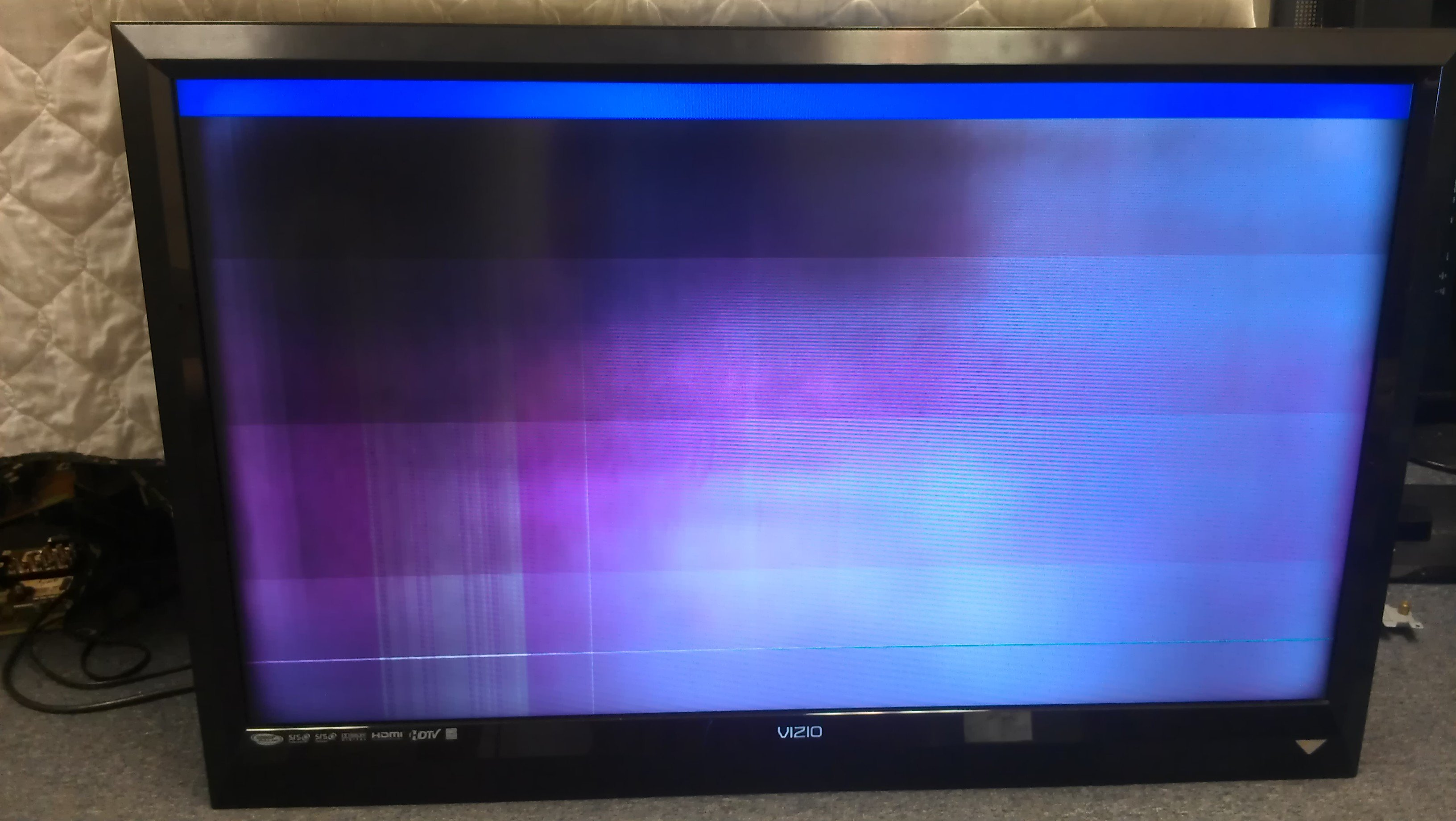 I have a VL470M that has a purple cloud when I first turn the tv on