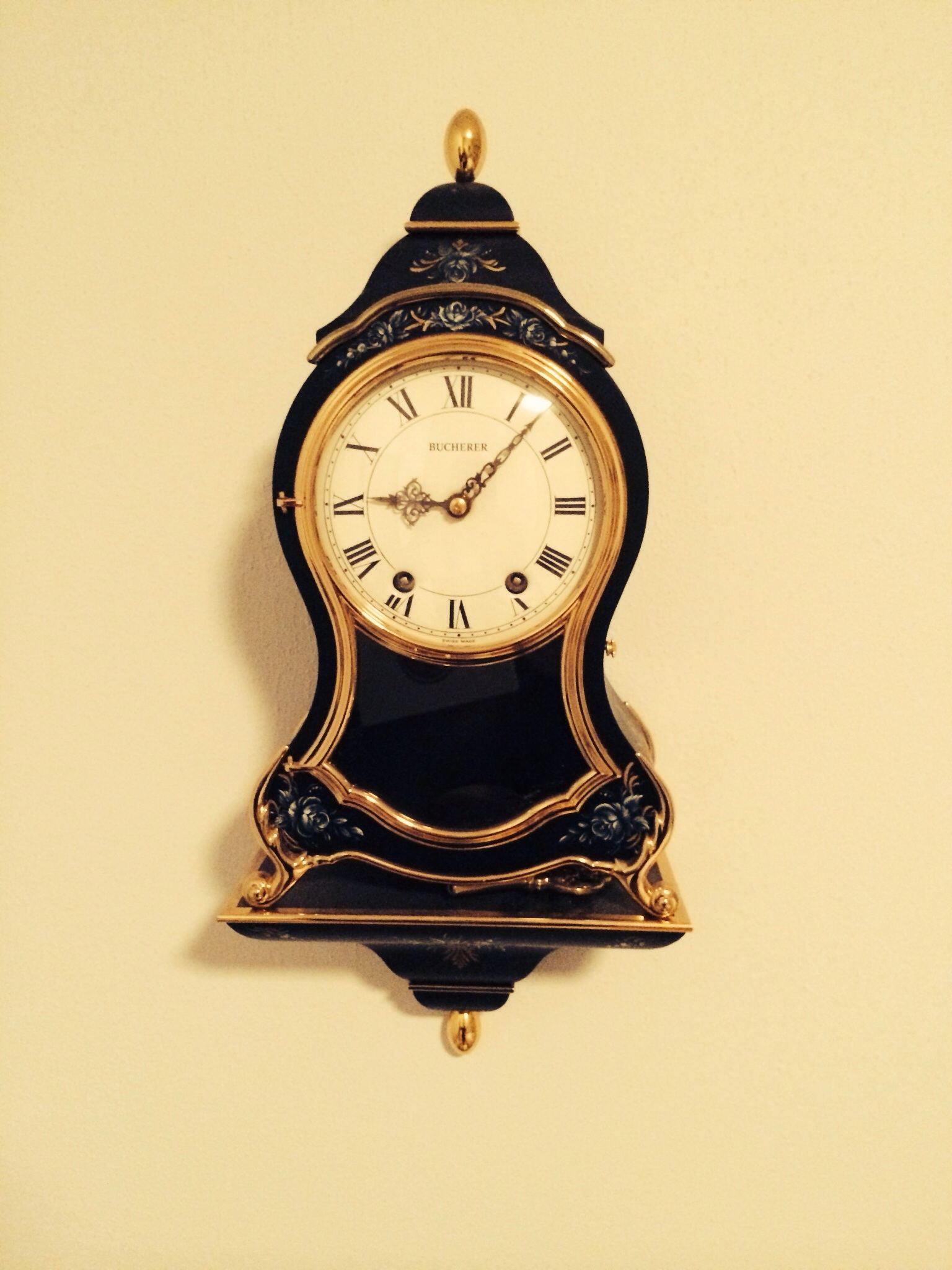 I Am Seeking Info Concerning An Antique Swiss Wall Clock We Believe It To Be Made By Bucherer And Dates To The Late