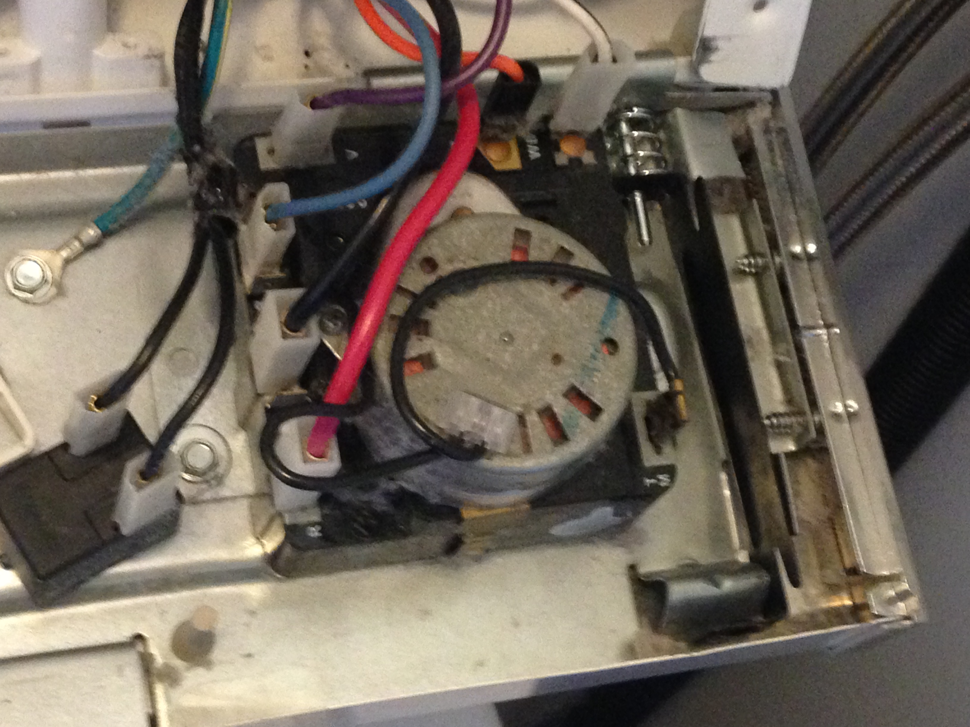 How do I reset or close the control panel of a Whirlpool