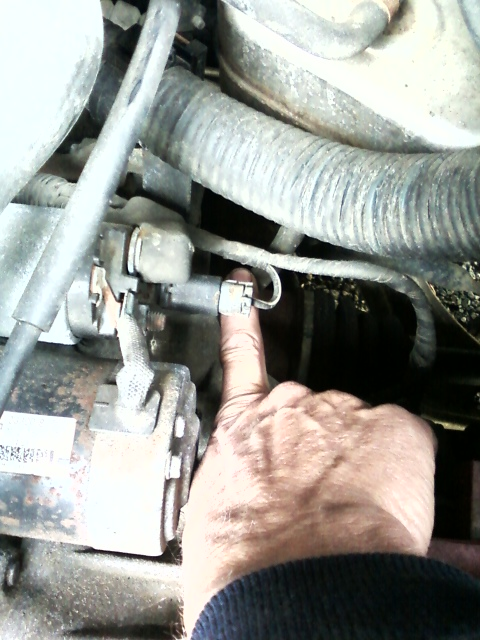 2003 Nissan Altima 2 5L with a disconnected vacuum line on a