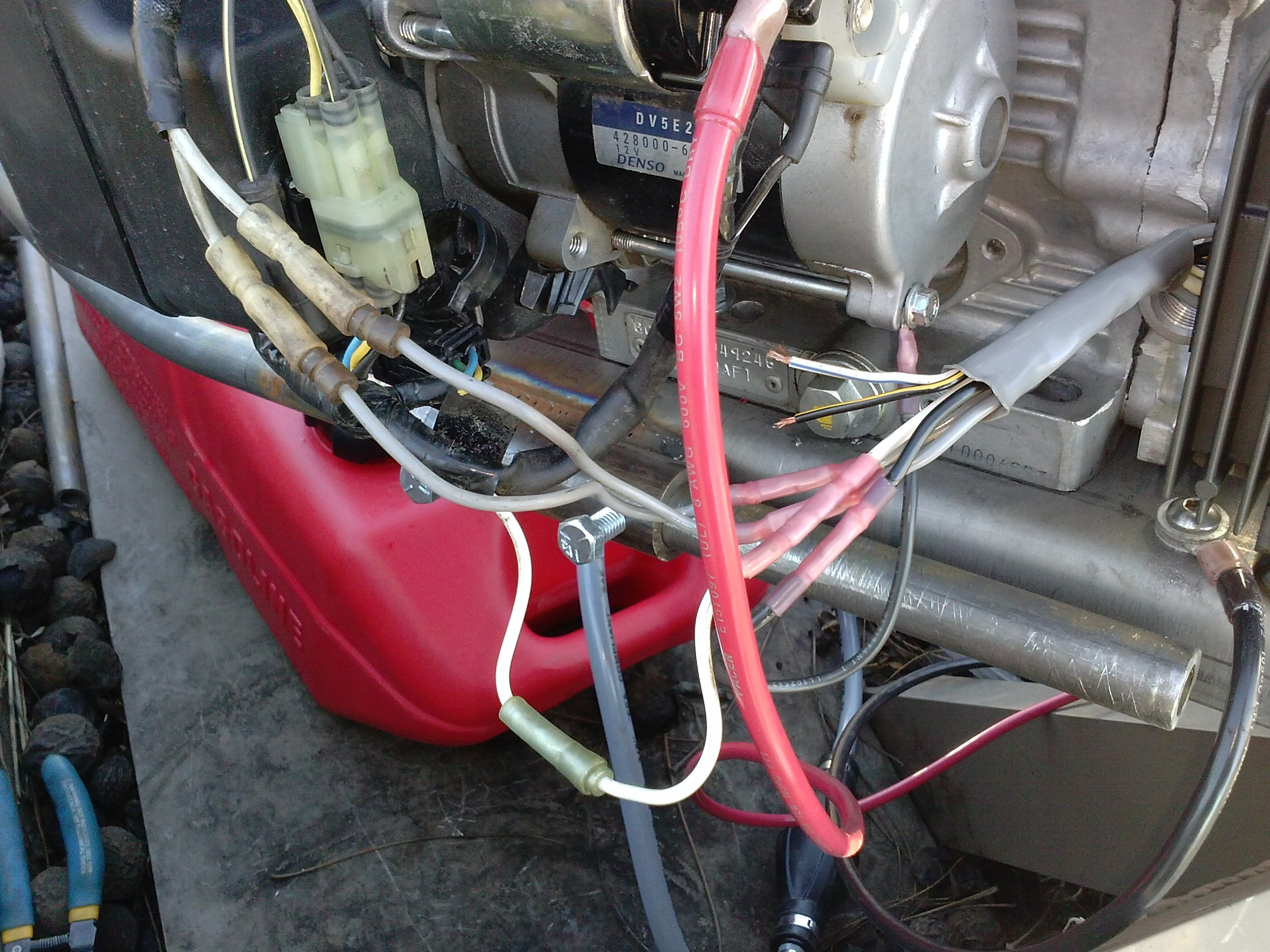 I need help troubleshooting the charging system on a honda ...