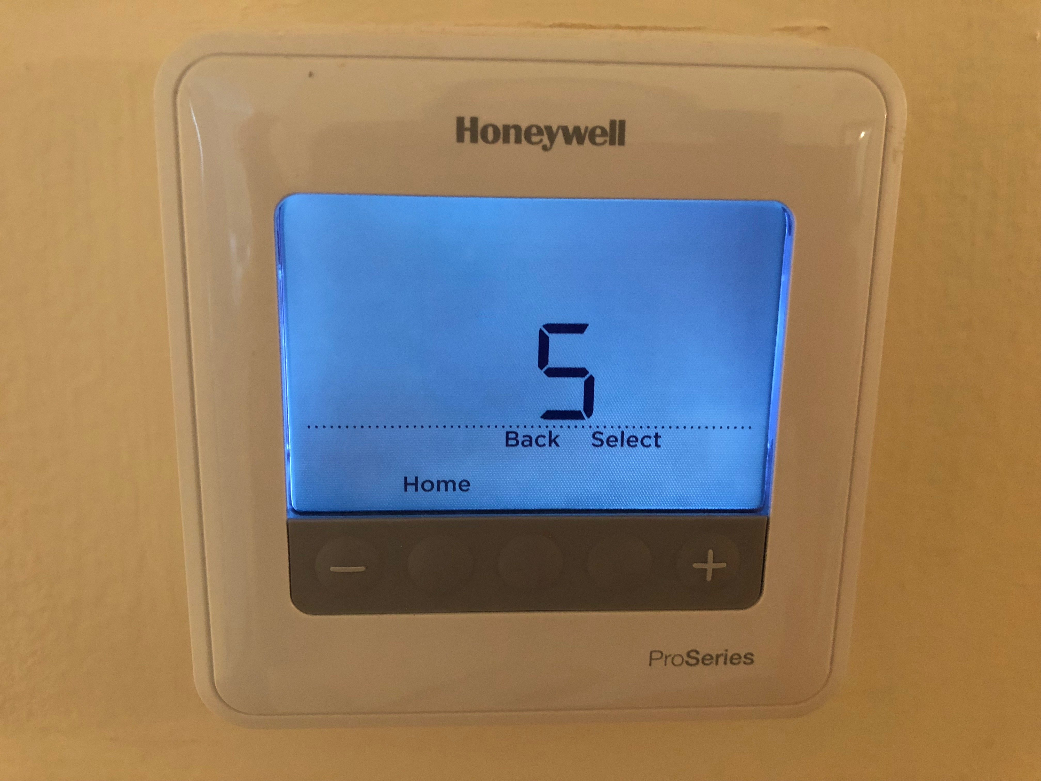 My Honeywell Proseries thermostat is locked  How do I unlock